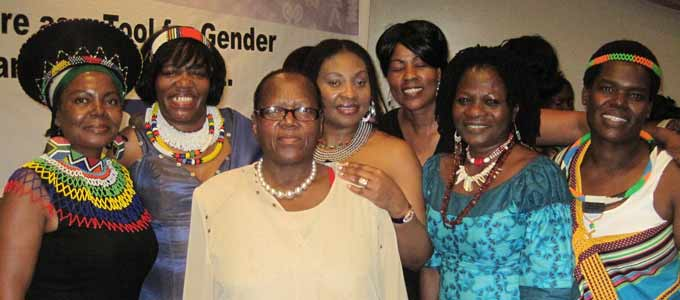 Yvonne Chaka Chaka (4th from left), Della in blue next to her